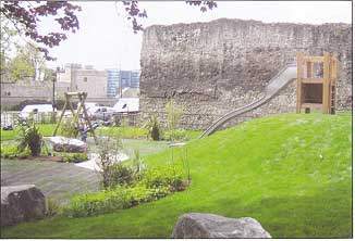 Childen's play area in front of the Roman wall at Tower Hill
